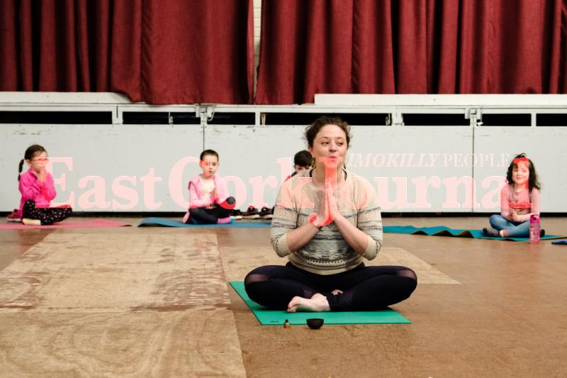 Yoga teacher Kathryn Sheehan begins her class